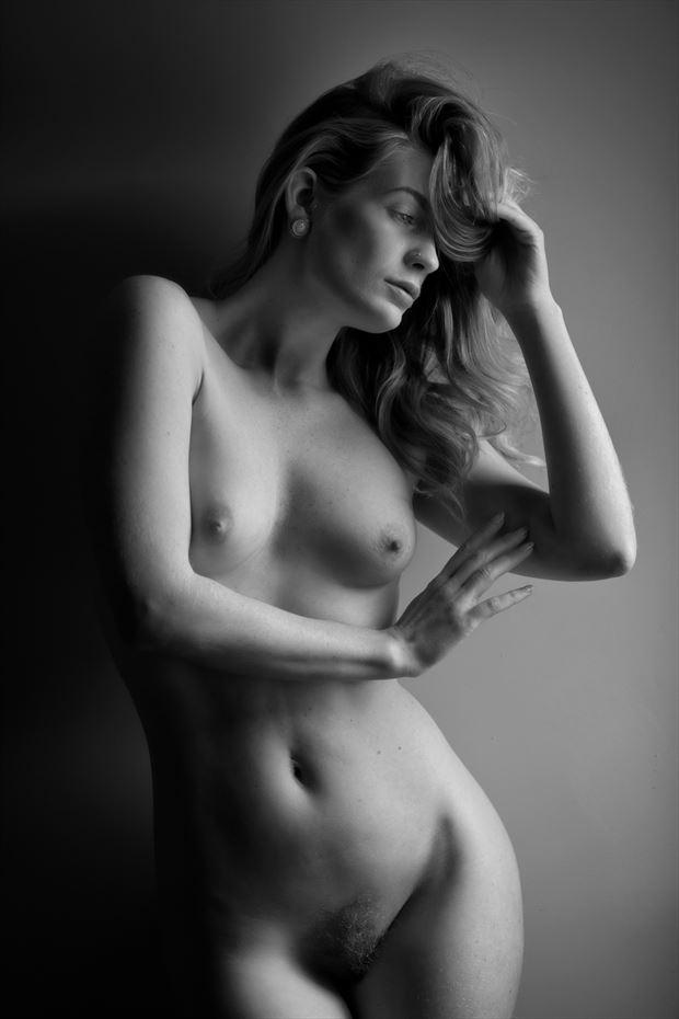 artemis in the window light artistic nude photo print by photographer colin dixon