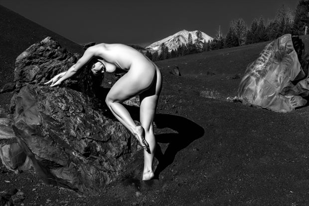 nude lava field and boulders artistic nude photo print by photographer philip turner