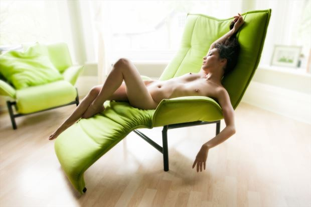 rebecca languishing in the green chair artistic nude photo print by photographer ian cartwright