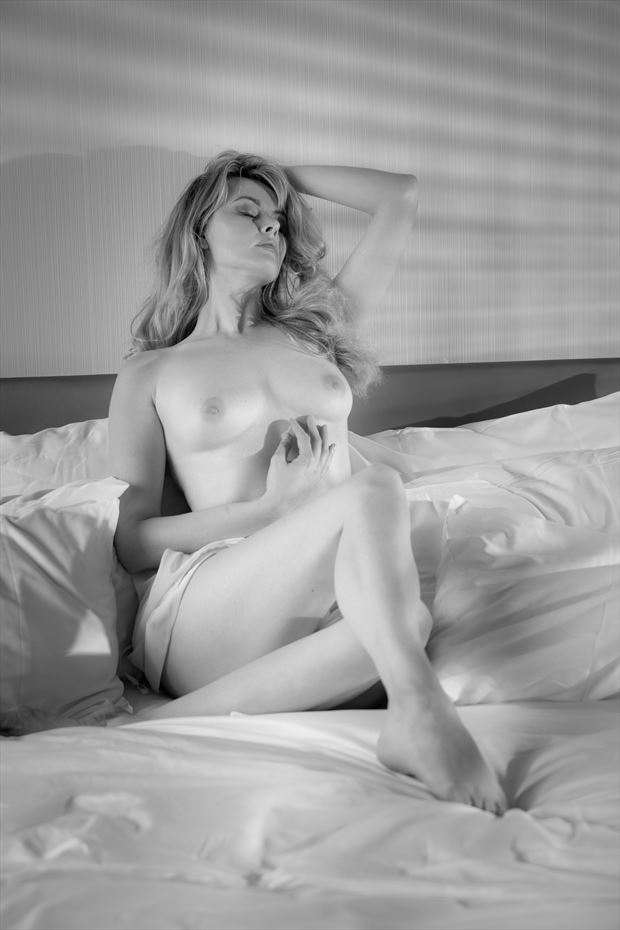 waiting in bed deep in thought artistic nude photo print by photographer colin dixon