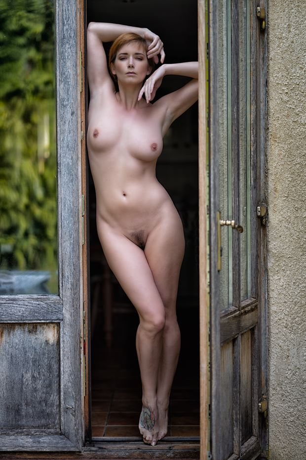 waiting in the doorway artistic nude photo print by photographer colin dixon